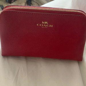 red coach makeup bag